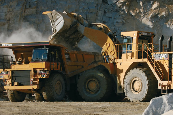 Cat Wheel Loader Dumping Aggregate in Cat Articulated Truck