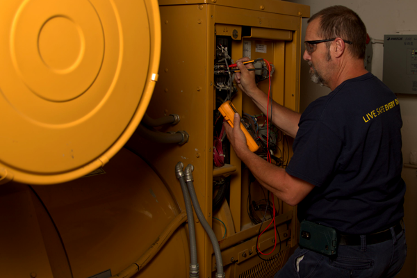 Yancey Technician Performing Inspection & Testing on Generator