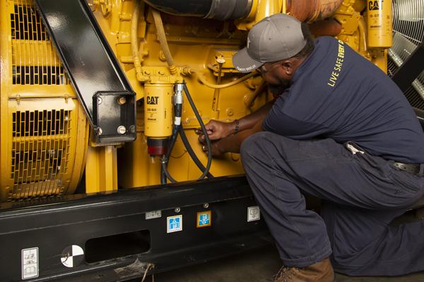 Yancey Technician Repairing on Cat Generator