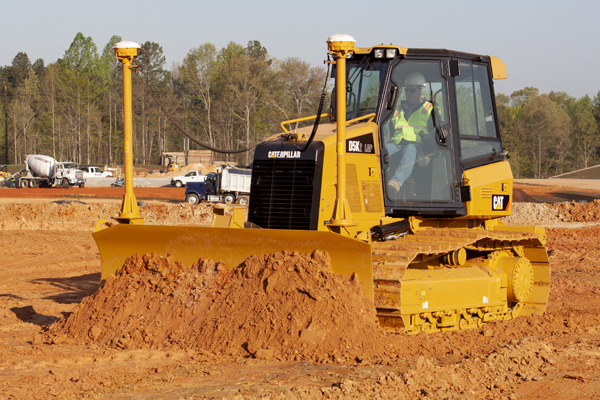 Cat D5K Dozer Pushing Dirt