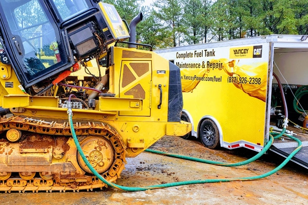 Dozer Filling Up with Mobile Yancey Fuel Solutions Truck