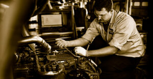 Yancey Technician Working on Truck Engine