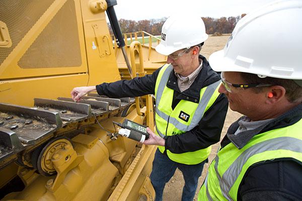 Yancey Technicians Inspecting Equipment Tracks